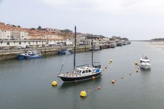 Boats in the estuary of San Vicente de la Barquera, Cantabria, S. Ría de San Vicente de la Barquera, with several boats docked, Cantabria, Spain Royalty Free Stock Photos