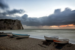 Boats on Etretat beach at sunset Stock Photos