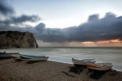 Boats on Etretat beach at sunset Stock Photos