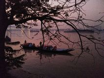 Boats   Evening   Ganges  . People spending a peaceful time on boats at the holy Ganges in Kolkata, INDIA stock images