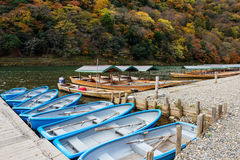 Boats with fall colors, Arashiyama Royalty Free Stock Images