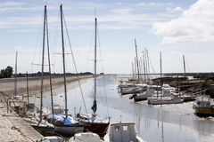 Boats falling dry at low tide in Noirmoutier Royalty Free Stock Photography