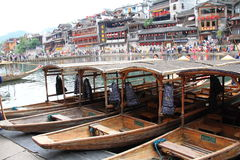 Scenic of Fenghuang, China. Boats in Tuo river in the historic small town Fenghuang in China. A famous tourist attraction Royalty Free Stock Photography