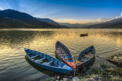 Boats on fewa lake in pokhara, nepal Royalty Free Stock Photos