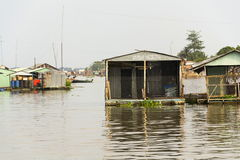 Boats with fish farm raft houses on Mekong river, Vietnam Stock Image