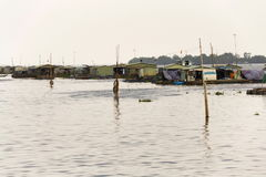 Boats with fish farm raft houses on Mekong river, Vietnam Royalty Free Stock Photo