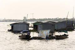 Boats with fish farm raft houses on Mekong river, Vietnam Royalty Free Stock Photos