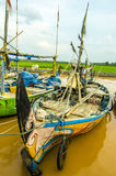 Boats Fishermen Indonesian people on the river downstream. Stock Image