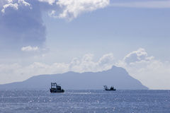 Boats fishing. View of boats fishing off San Felice, Circeo in Italy Stock Images