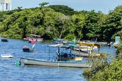 Boats Fishing boats Fishermen Sunny day Sea and mountain Blue sea Sea and trees Stock Photo