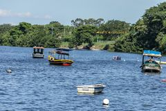 Boats Fishing boats Fishermen Sunny day Sea and mountain Blue sea Sea and trees Stock Images
