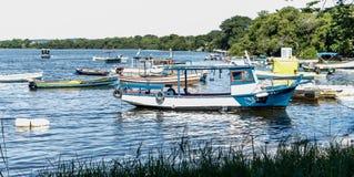 Boats Fishing boats Fishermen Sunny day Sea and mountain Blue sea Sea and trees Royalty Free Stock Photography