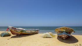 Boats and fishing net on the beach, Sri Lanka Royalty Free Stock Photos