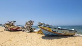 Boats and fishing net on the beach, Sri Lanka Stock Photo