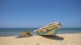 Boats and fishing net on the beach, Sri Lanka Stock Photos