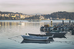 Boats in a fishing port Stock Images
