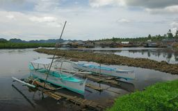 Boats with a fishing village. On Siargao Island,Philippines Royalty Free Stock Photo