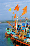 Boats with flags. Boats with orange flags with blue sky Royalty Free Stock Photos