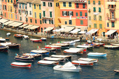Boats floating along multicolored houses. Royalty Free Stock Images