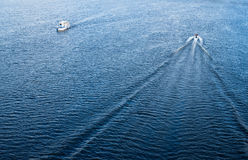 The boats floating in the blue Dnieper waters Royalty Free Stock Photography