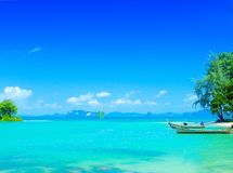 boats floating in the clear waters of the bay Royalty Free Stock Images