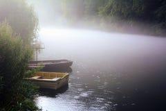 Boats in fog Stock Photo