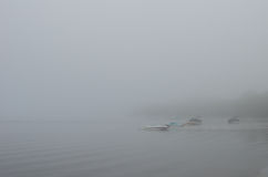Boats in fog Royalty Free Stock Images