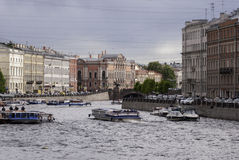 Boats on the Fontanka. SAINT-PETERSBURG, RUSSIA - MAY 27, 2015: Boats on the Fontanka River. Cloudy weather in Sankt-Petersburg, May 27, 2015, Russia Stock Photos