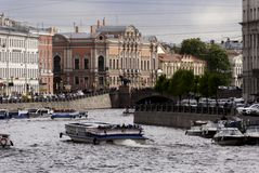 Boats on the Fontanka. SAINT-PETERSBURG, RUSSIA - MAY 27, 2015: Boats on the Fontanka River. Cloudy weather in Sankt-Petersburg, May 27, 2015, Russia Stock Photo