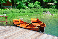 Boats on a forest lake Royalty Free Stock Images