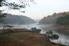 Boats on forest lake Stock Photography