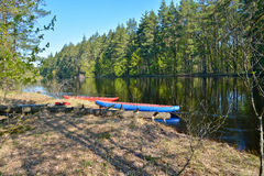 Boats on the forest river. Royalty Free Stock Photos