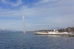 Boats and fountain on Geneva lake Stock Photos