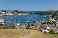 Boats on Fowey river Cornwall blue sea and sky. Fowey Cornwall from Polruan England near St Austell on a beautiful summer day Stock Images