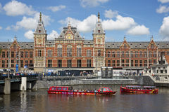 Boats in front of amsterdam central railway station Stock Photo