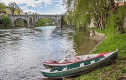 Boats in front of the roman bridge in Amarante stock photos