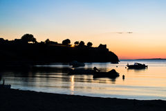 Boats in front of ruins of a roman fortress at sunset, Sithonia Royalty Free Stock Image