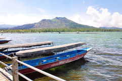 Boats in front of volcano Batur in Lake. Indonesia, Bali Stock Photos