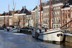 Boats in a frozen canal royalty free stock images