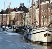 Boats in a frozen canal Royalty Free Stock Photo