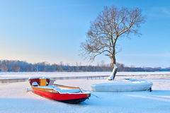 Boats on the frozen river. Stock Photos