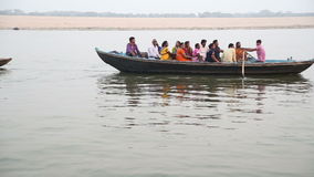 Boats full of people sailing through Ganges river in Varanasi. stock video