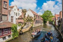 Boats full of tourist enjoying Bruges stock photo