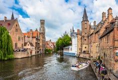 Boats full of tourist enjoying Bruges royalty free stock photos