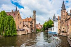 Boats full of tourist enjoying Bruges stock image