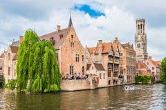 Boats full of tourist enjoying Bruges stock photography