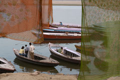 Boats on The Ganges. Through Saris at Varanasi, India Stock Photo