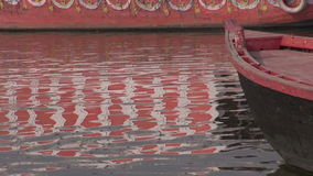 Boats on Ganges river in sacred indian city Varanasi stock footage