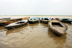 Boats on Ganges river in Varanasi, India. Boats on Ganges holy river in Varanasi, India Stock Photo