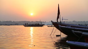 Boats on Ganges river in Varanasi at sunset. stock video footage